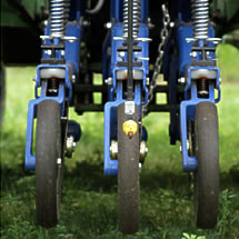 Packing wheels and herbicide nozzles